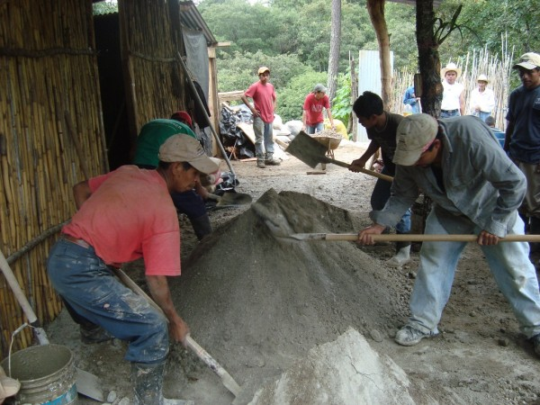 Men mixing concrete